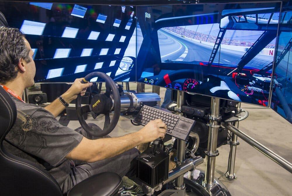 Man comfortably seated at racing simulator