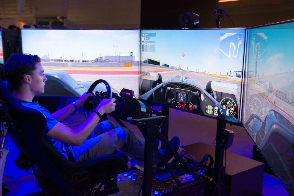 Racing simulator with triple monitor setup