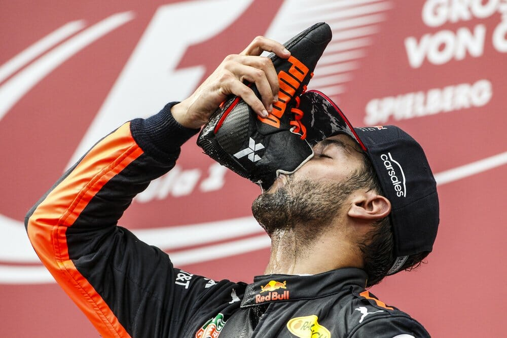 Formula One racer drinking from shoe