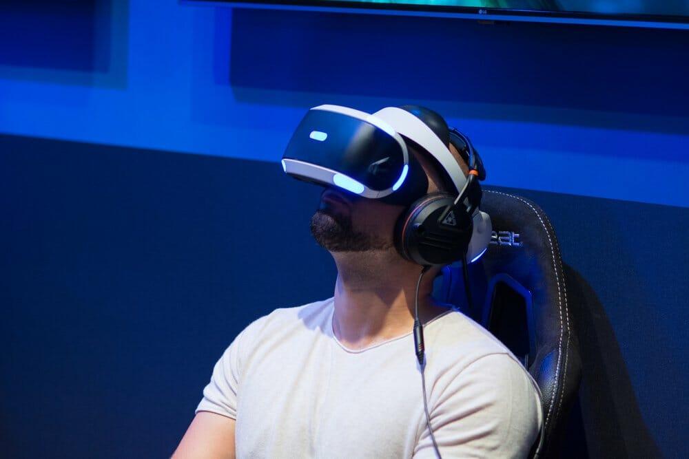 Man wearing VR headset in flight simulator