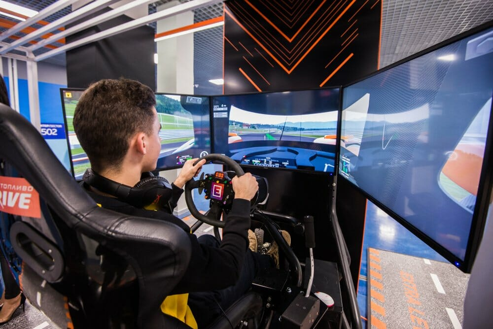 Man sitting in sim racing cockpit